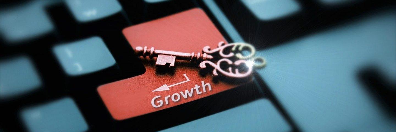 """Schlüssel auf einer Tastatur, direkt auf der Return-Taste, die mit """"Growth"""" beschriftet ist"""